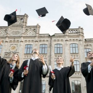 graduation-concept-with-student-throwing-hats-air_23-2148201878